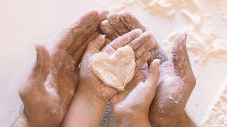 Family Love. Father And Daughter Holding Heart Shaped Dough On Hands Baking Together In Kitchen Indoor. Closeup, Panorama