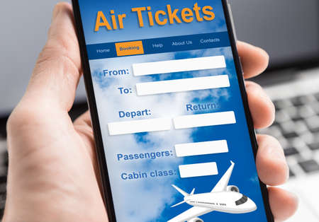 Man Booking Flight Tickets Online Using Smartphone Sitting At Workplace Indoors. Closeup, Collage, Cropped Imagens