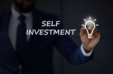 Self Growth Investment Concept. Unrecognizable African Businessman Drawing Lightbulb On Invisible Sreen Over Black Background. Cropped, Collage