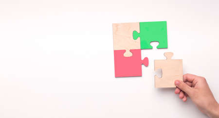 Woman Putting Wooden Puzzle Together Over White Background. Creativity And Problem Solving Concept. Panorama, Collage, Copy Space