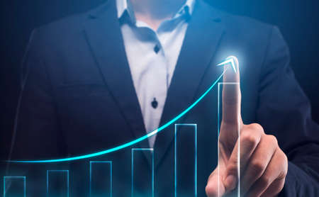 Business Growth Concept. Unrecognizable Businessman Drawing Arrow Upward On Transparent Screen Over Blue Background. Collage, Cropped