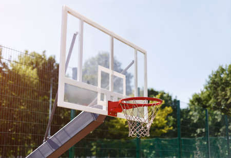 Basketball backboard with empty basket at outdoor sports arena, free space