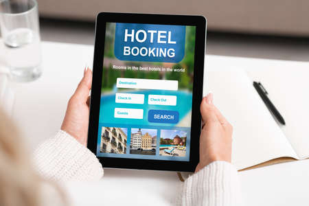 Businesswoman Booking Hotel Accommodation Online Using Digital Tablet Sitting At Workplace Indoor. Cropped, Collage