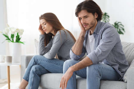 Marriage, relationships issues. Sad married couple avoiding each other, having fight, home interior Banque d'images