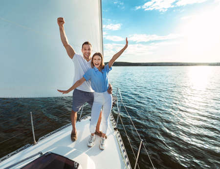 Couple Having Fun On Yacht Posing Standing On Sailboat Deck Sailing On Summer Day On River. Free Space