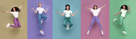 Group Of Five Multicultural Women Jumping Posing In Mid-Air In Different Poses Having Fun Over Colorful Studio Backgrounds, Smiling To Camera. Bright Colored Collage, Panorama, Full Length 免版税图像