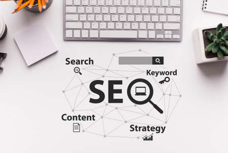 Seo Strategy. Seo-Optimization Scheme With Words Over White Office Desk Background With Computer Keyboard. Search Engine Optimization For Internet Content. Collage, Top View