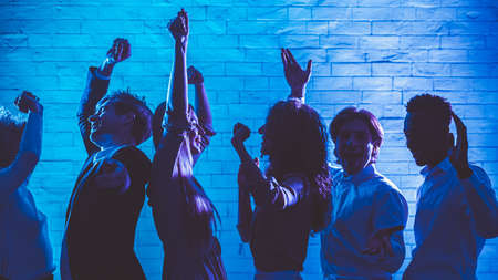 Party Concept. Happy Diverse Millennials People Dancing Having Fun Celebrating Holiday Or Corporate Event Indoor. Panorama, Low Light