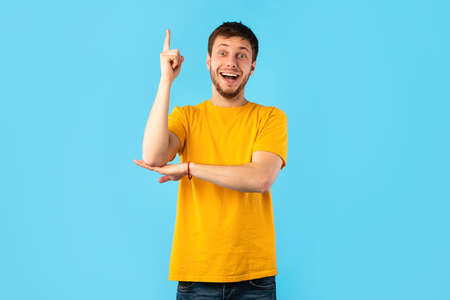 I Have An Idea Concept. Young Funny Man Pointing Finger Up. Excited Guy Knows Answer, Got Solution To His Problem, Having Aha Moment Or Inspiration, Isolated On Blue Studio Background. Wow, Eureka
