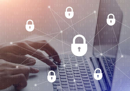 Cyber And Information Or Network Security. Illustration of man typing on laptop keyboard, double exposure with padlock icons hologram. Protect your data from fraud and online crime concept