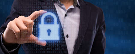 Internet Privacy, Technology And Data Protection Concept. Closeup of businessman holding virtual security hologram with padlock. Panorama, banner with binary code in the background