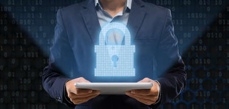 Cyber And Information Or Network Security. Illustration of businessman holding digital tablet with padlock icon hologram, binary code in the background. Protect your data from fraud and online crime