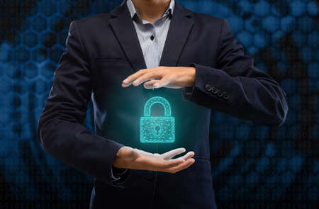 Cyber Security. Illustration of businessman holding hologram of polygonal geometic padlock icon in hands. Protection network security computer and safe your data from fraud and online crime concept 免版税图像