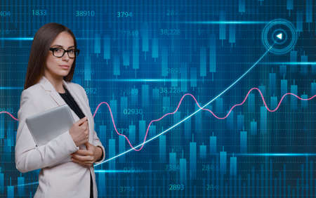 Business growth concept. Businesswoman standing over economical background with raising virtual financial chart and trading investment candlesticks, corporate progress analytics, creative collage,