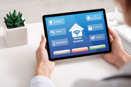 Smart House Control. Unrecognizable Woman Using Digital Tablet With Home Automation System On Screen, Monitoring Her Property Online From Work, Sitting At Desk In Office, Creative Collage, Closeup