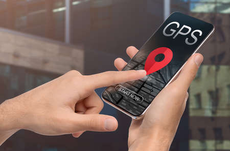 Man Using Modern Gps Navigation App On Smartphone, Unrecognizable Male Browsing Application With Online Maps For Tracking Location And Planning Routes, Creative Collage, Closeup Stock Photo