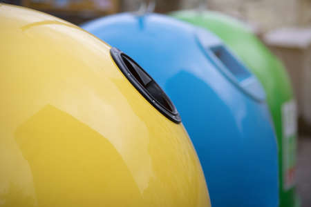Outdoor Shot Of Different Colorful Garbage Containers For Waste Sorting, Image Of Yellow Blue And Green Trash Recycling Bin For Diverse Kind Of Waste, Closeup With Selective Focus