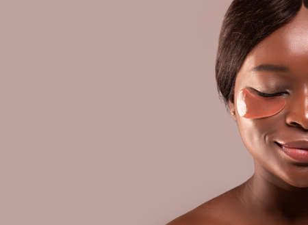 Beauty And Skin Care. Half Portrait Of Attractive Black Female With Under Eye Patches Standing Isolated Over Gray Background, Cropped Image, Closeup With Copy Space Stock fotó