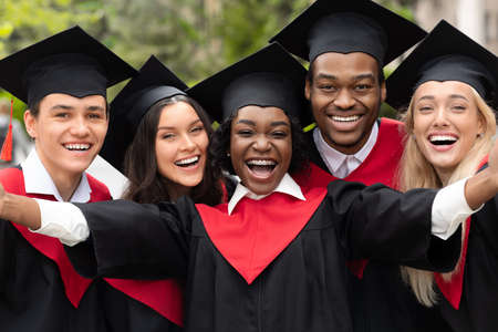 Happy multiracial group of students taking selfie, closeup