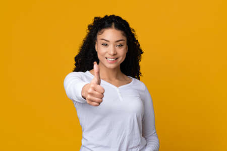 I Like It. Smiling African American Female Showing Thumb Up At Camera