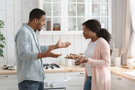 Crisis In Relationship. Portrait Of Black Man And Woman Arguing In Kitchen