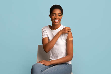 After Vaccination Concept. Vaccinated Black Woman Showing Arm After Coronavirus Vaccine Injection Standard-Bild