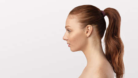 Profile Portrait Of Red-Haired Female Looking At Copyspace, White Background