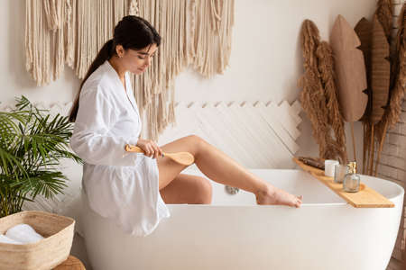 Lady Dry Brushing Legs Making Massage For Cellulite Prevention Indoor
