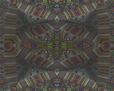 embossment: Coloured embossment: This image has a symmetrical structure, which has the appearance of rocky embossment. Dissected surface of embossment complemented the color ornaments.