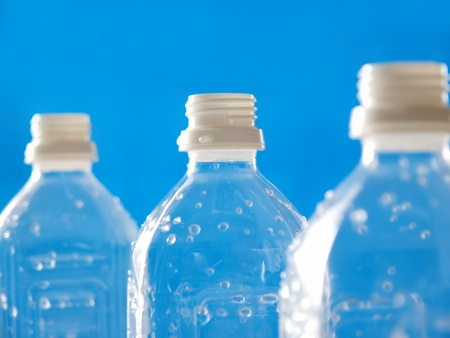waste products: plastic bottles in line