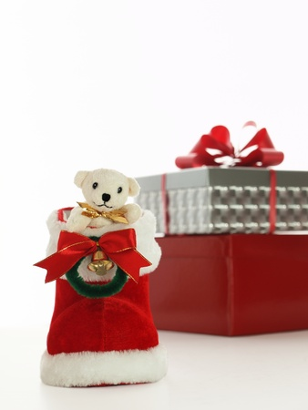 teddy bear, christmas boot, and present photo