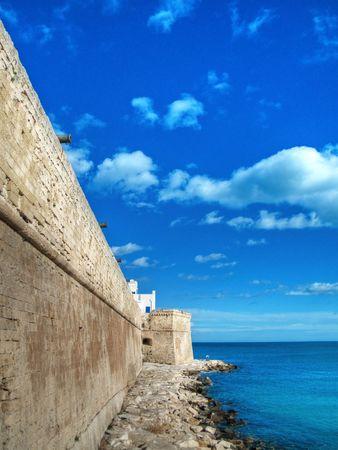 resides: Tourism: Ancient walls of Monopoli. Apulia.
