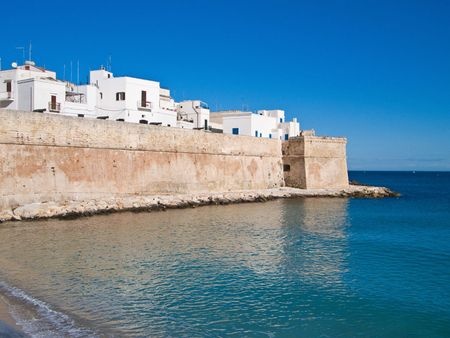 resides: Tourism: These are an ancient walls of Monopoli. Apulia.