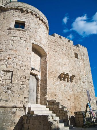 crenellated: Tourism: This is the Carlo V Castle with your crenellated tower. Monopoli. Apulia.
