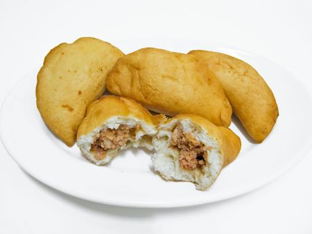 caloric: Food: This is a typical speciality of the southern Italy:bread dough,fried and stuffed, called panzerotto or calzone.