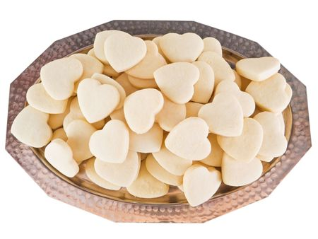 Food: This is a silver tray with shortbreads hearts. photo