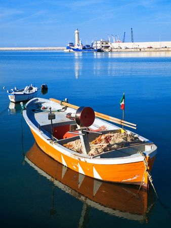 Landscape view of Molfetta touristic port with rowboats. photo