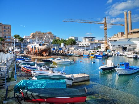 Landscape view with factory of Monopoli port. Apulia. photo