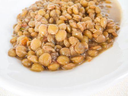 Lentil soup on white dish.  photo