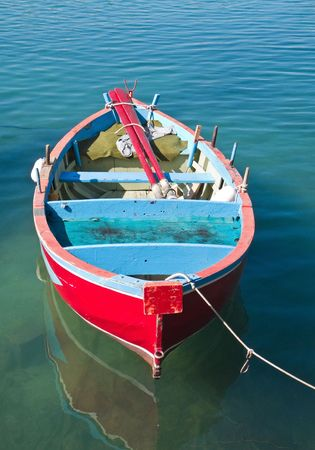 rowboats: Coloured rowboat in clear sea.