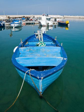 Blue rowboat in clear sea.  Stock Photo - 6690249