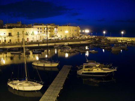 Night view of Giovinazzo seaport. Apulia.  photo
