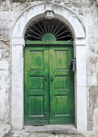 Green ancient frontdoor.  photo