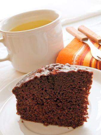 Chocolate Cake Slice on white dish. photo