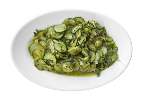 thinly: Courgettes sliced thinly and cooked with olive oil and onions.