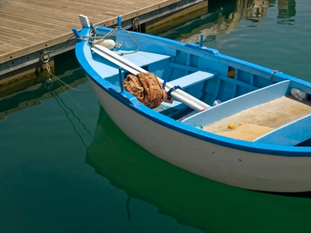 wooden dock: Boat moored at the floating bridge.