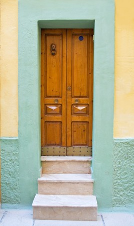 Wooden frontdoor. Stock Photo - 6928270