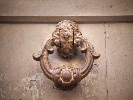 rustiness: Ancient doorknocker. Stock Photo