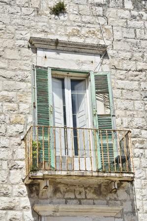 crumbling: Crumbling window on brickwall.