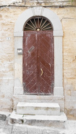 scraped: Wooden crumbling frontdoor.